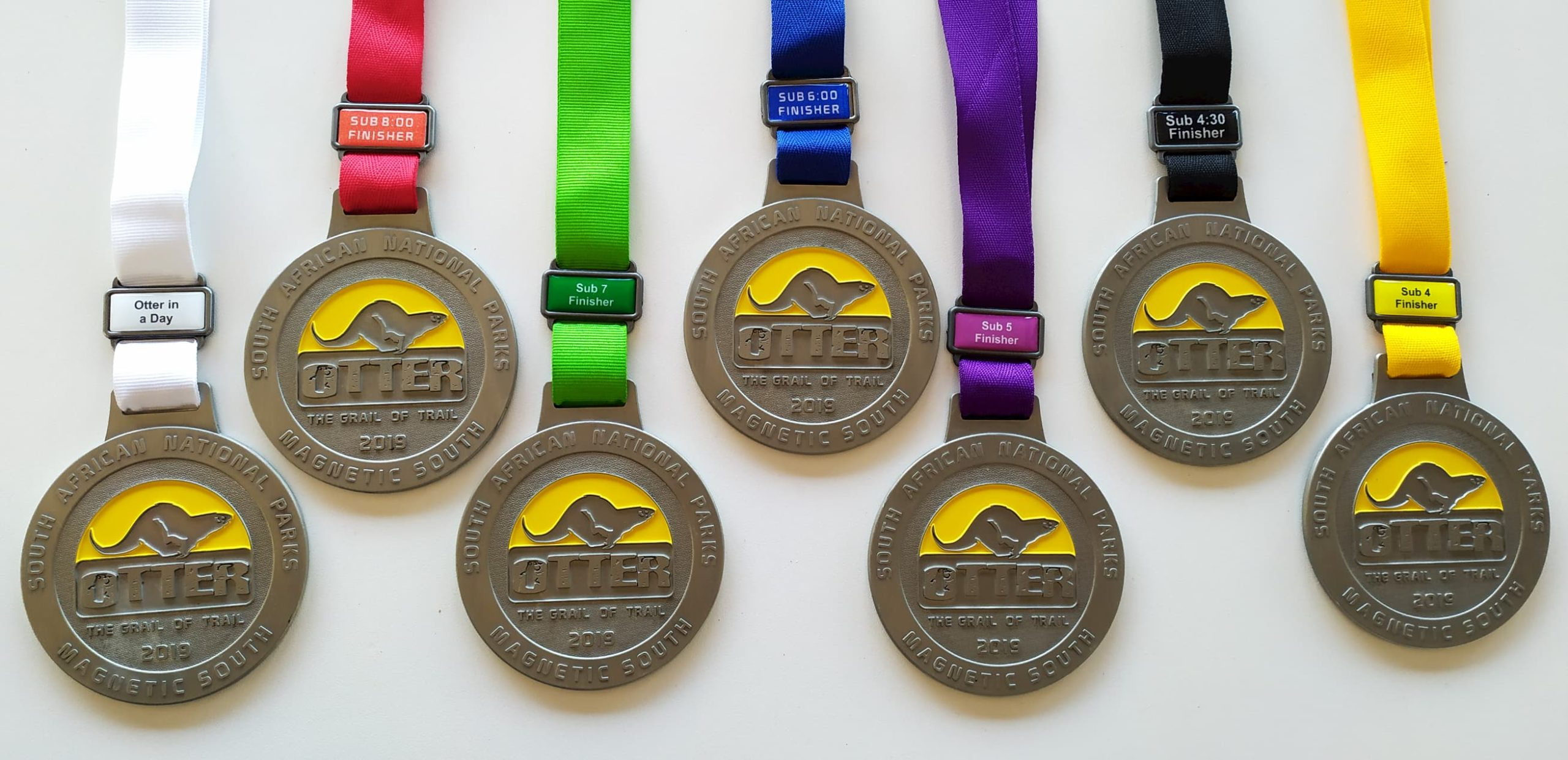 OTTER Grail of Trail Medals